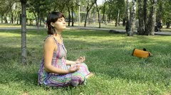Young pregnant woman in the park, yoga Stock Footage