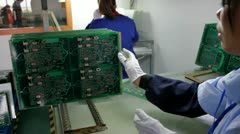 Stock Video Footage of Inspection of Printed Circuit Boards - PCB