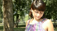 Young pregnant woman in a striped dress Stock Footage