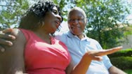 Retired Ethnic Seniors Sitting Outdoors Stock Footage