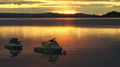 Jet Skis on Mooring at Sunset Lake Evening Stock Footage