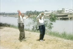 Iraq 1950s - American tourist dancing with guide Stock Footage