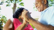Stock Video Footage of Retired Ethnic Seniors Dancing Outdoors