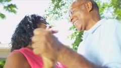 Senior Couple Enjoying Retirement Living Dancing Outdoors Stock Footage