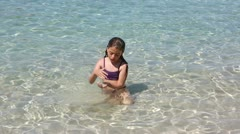 Beautiful little girl playing in ibiza beach on vacation Stock Footage