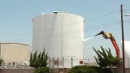 Demolition Excavator Rips Open Fuel Storage Tank Stock Footage