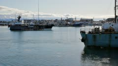 Industrial boats in the harbor in Homer Alaska Stock Footage