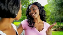 African American Mom Teenage Daughter Together Outdoors - stock footage