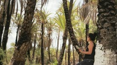 Woman with tablet and palmtrees Stock Footage