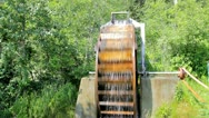 Water wheel in action in Moose Pass Alaska Stock Footage
