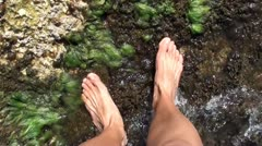 Bare feet in sea water 3 Stock Footage