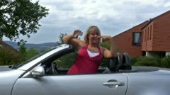 Female driver shows license Stock Footage