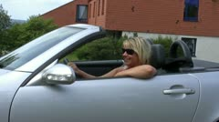 Female driver with sunglasses Stock Footage