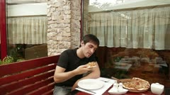 Man eating pizza in cafe Stock Footage