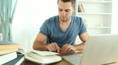 Man doing research with books - stock footage