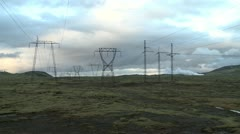 Electrical poles and steam in icelandic countryside Stock Footage