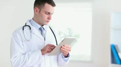 Doctor using a tablet tactile Stock Footage