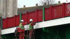 Weymouth UK, worker painting draw-bridge for Olympic Games, Old Harbour Stock Footage