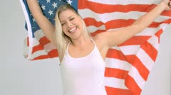 Happy woman in slow motion holding the American flag Stock Footage
