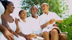 Ethnic Parents Laughing Children Outdoors - stock footage