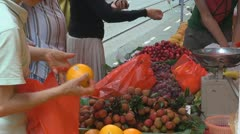 Fruits for sale, street market, Hong Kong, China - stock footage