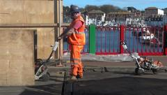 Weymouth UK, worker preparing draw-bridge for Olympic Games, Old Harbour Stock Footage