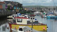 Weymouth UK, Inner Harbour with Olympic Games Sailing flags - stock footage