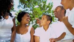 Ethnic Parents Laughing Family Outdoors Stock Footage