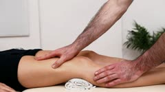 Physiotherapist massaging the thigh on a table Stock Footage