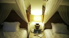 Beds at the hotel in the evening Stock Footage