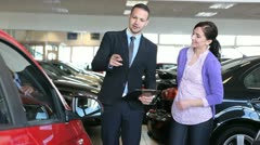 Businessman showing a car - stock footage