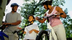 Healthy Fit Ethnic Family Cycling Suburban Roads Stock Footage