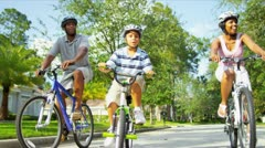 Healthy Ethnic Family Bike Riding Together Stock Footage