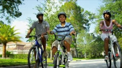Young Ethnic Family Cycling Together Stock Footage