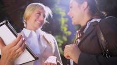 Businesswomen using wireless tablet Stock Footage