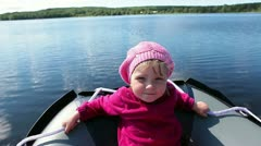 One small child on motorboat stern during movement Stock Footage