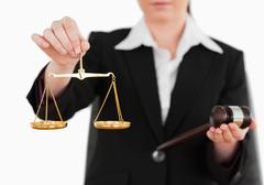 Woman holding a gavel and scales of justice Stock Photos