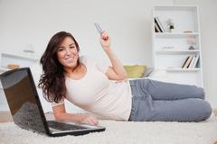 Stock Photo of Attractive brunette female making a payment