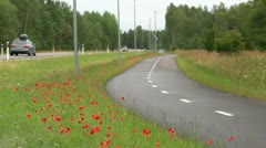 Bicycle road next to main highway Stock Footage