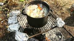 Russian fish soup on fire 1 Stock Footage