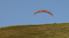 Paraglider Low Angle Launch and Glide Over Ridge Stock Footage