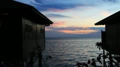 Tropical island sunset Stock Footage