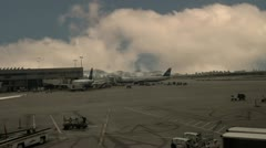 Time passing LAX Airport time lapse clouds blowing cutaway transition Stock Footage