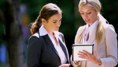 Young businesswomen using tablet - stock footage