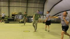 Soldiers playing dodge ball for Army pt (HD)c Stock Footage
