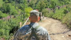 Soldiers on patrol down dirt road (HD)c Stock Footage