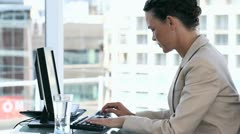 Business woman using a computer Stock Footage