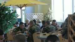 Stock Video Footage of soldiers eating in mess hall (HD)c