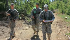 Soldiers on patrol through woods (HD)c Stock Footage