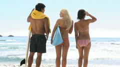 Stock Video Footage of Friends looking at the sea with a surfboard
